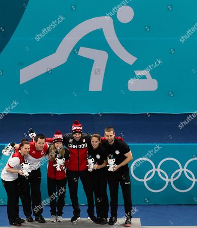 Gold medal winner John Morris (R) and teammate Kaitlyn Lawes (L) of Canada celebrate on the podium for the Mixed Doubles final with silver medalist Roman Rios (2L) and Jenny Perret(L)  of Switzerland and bronze medalists, Oplympic Athletes from Russia, Aleksandr Krushelnitckii (R) and Anastasia Bryzgalova (2R) at the Gangneung Curling Centre during the PyeongChang Winter Olympic Games 2018, in Gangneung, South Korea, 13 February 2018.
