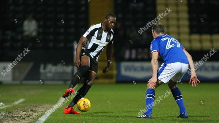 Shola Ameobi looks to get the better of Carlisle's Clint Hill