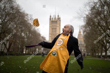Official Race Starter Alastair Stewart OBE flips a pancake of the Rehab Parliamentary Pancake Race 2018