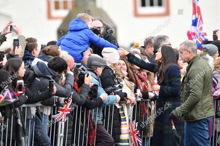 Meghan Markle greets people outside Edinburgh Castle