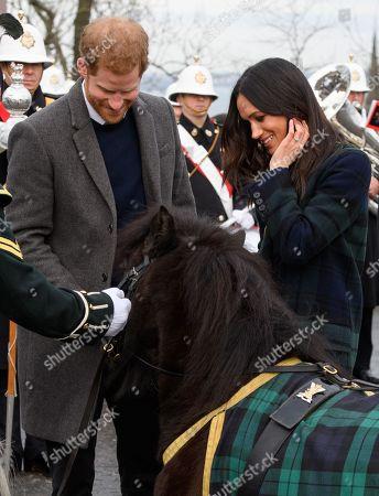 Prince Harry, Meghan Markle outside Edinburgh Castle