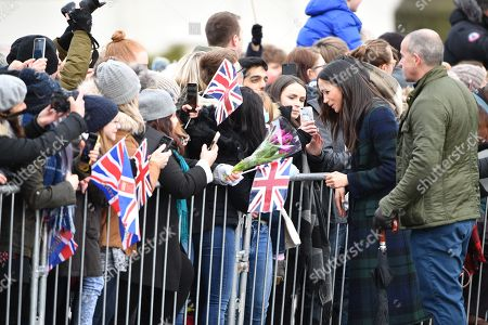 Stock Picture of Meghan Markle greets people outside Edinburgh Castle