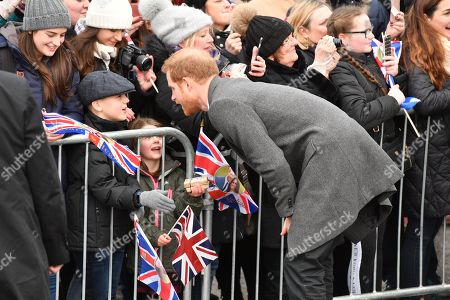 Prince Harry greets people outside Edinburgh Castle