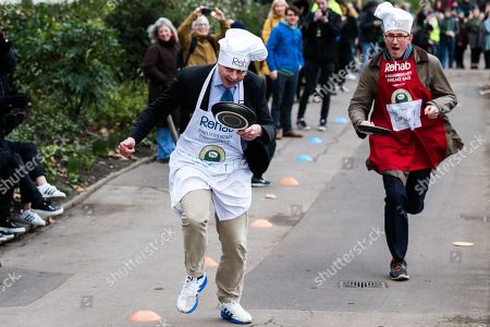 Matt Warman and James Landale during the Rehab Parliamentary Pancake Race.