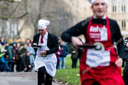Stock Image of Lewis Goodall and Bambos Charalambous during the Rehab Parliamentary Pancake Race.