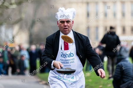 Stock Picture of Bambos Charalambous during the Rehab Parliamentary Pancake Race.