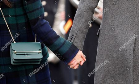 Britain's Prince Harry and his fiancee Meghan Markle hold hands as they arrive at Edinburgh Castle in Edinburgh, Scotland,. The recently engaged couple are on a one day tour to Edinburgh, and will visit the Castle and observe the firing of the One O'clock Gun
