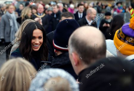 Britain's Prince Harry and his fiancee Meghan Markle, left, meet people as they arrive at Edinburgh Castle in Edinburgh, Scotland,. The recently engaged couple are on a one day tour to Edinburgh, and will visit the Castle and observe the firing of the One O'clock Gun