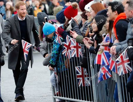 Britain's Prince Harry greets the public as he and his fiancee Meghan Markle arrive at Edinburgh Castle in Edinburgh, Scotland,. The recently engaged couple are on a one day tour to Edinburgh, and will visit the Castle and observe the firing of the One O'clock Gun