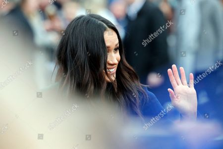 Meghan Markle, fiancee of Britain's Prince Harry waves as she arrives at Edinburgh Castle in Edinburgh, Scotland,. The recently engaged couple are on a one day tour to Edinburgh, and will visit the Castle and observe the firing of the One O'clock Gun