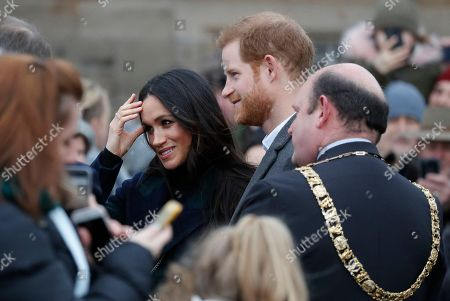 Britain's Prince Harry and his fiancee Meghan Markle arrive at Edinburgh Castle in Edinburgh, Scotland,. The recently engaged couple are on a one day tour to Edinburgh, and will visit the Castle and observe the firing of the One O'clock Gun