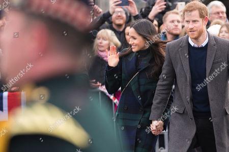 Prince Harry and his fiancé Meghan Markle visit Edinburgh Castle in Scotland.