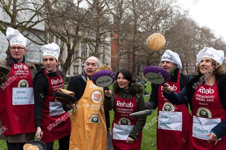 (L-R) Media Team members: James Landale, Lewis Goodall, Alastair Stewart OBE (Official Starter), Lucrezia Millarini, Angus Walker and Jo Coburn practice flipping their pancakes as they take part in the 21st Parliamentary Pancake Race