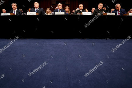 Dan Coats, Mike Pompeo, Michael Rogers, Christopher Wray, Robert Ashley, Robert Cardillo. From left, FBI Director Christopher Wray, CIA Director Mike Pompeo, Director of National Intelligence Dan Coats, Defense Intelligence Agency Director Robert Ashley, National Security Agency Director Adm. Michael Rogers, and National Geospatial-Intelligence Agency Director Robert Cardillo, appear before a Senate Select Committee on Intelligence hearing on worldwide threats, in Washington
