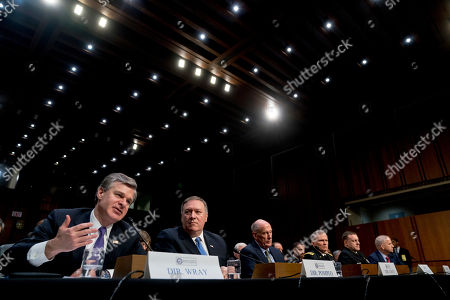 Dan Coats, Mike Pompeo, Michael Rogers, Christopher Wray, Robert Ashley, Robert Cardillo. From left, FBI Director Christopher Wray, accompanied by CIA Director Mike Pompeo, Director of National Intelligence Dan Coats, Defense Intelligence Agency Director Robert Ashley, National Security Agency Director Adm. Michael Rogers, and National Geospatial-Intelligence Agency Director Robert Cardillo, speaks at a Senate Select Committee on Intelligence hearing on worldwide threats, in Washington