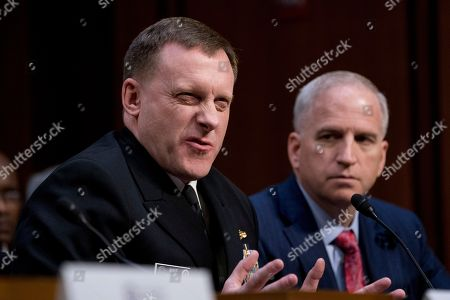 Michael Rogers, Robert Cardillo. National Security Agency Director Adm. Michael Rogers, accompanied by National Geospatial-Intelligence Agency Director Robert Cardillo, right, speaks at a Senate Select Committee on Intelligence hearing on worldwide threats, in Washington