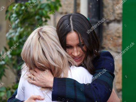 Meghan Markle hugging someone during a visit to the Social Bite social enterprise cafe