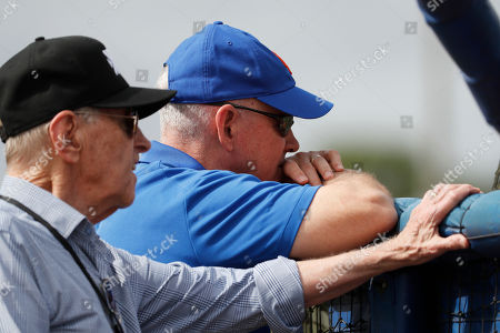 New York Mets general manager Sandy Alderson, right, and owner Fred Wilpon watch during spring training baseball practice, in Port St. Lucie, Fla