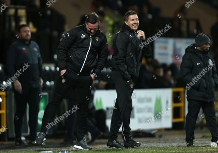 Notts County Manager, Kevin Nolan shares a joke with assistant Richard Thomas