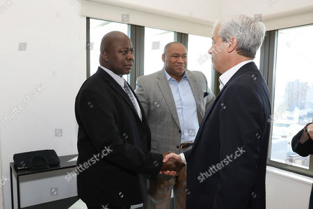 Stock Photo of Ralph Rolle, Loren Harris, Jamie Dimon. From left to right) The Soul Snacks Cookie Company President Ralph Rolle, The Nathan Cummings Foundation Vice President of Programs, Loren Harris, and JPMorgan Chase Chairman and CEO Jamie Dimon at the Entrepreneurs of Color Fund Launch in the South Bronx, NY on