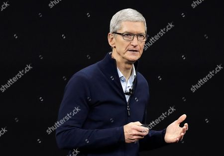 Apple CEO Tim Cook, shows new Apple Watch Series 3 product at the Steve Jobs Theater on the new Apple campus in Cupertino, Calif. Cook is leaving shareholders in suspense about whether the iPhone maker will use its windfall from a tax cut on overseas profits for a big boost to its quarterly dividend