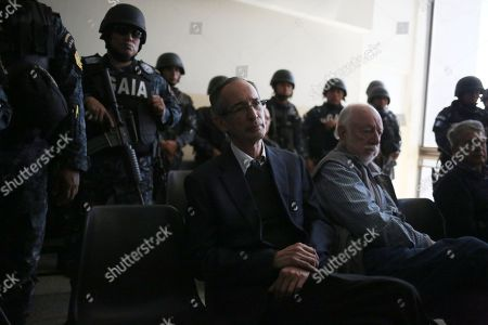 Former Guatemalan President Alvaro Colom (C) waits in the hearing room with ministers of his former cabinet in Guatemala City, Guatemala, 13 February 2018. Colom and nine of the 10 ministers of his former cabinet were arrested on corruption charges, including former finance minister Juan Alberto Fuentes Knight who is the current chairman of Oxfam International.