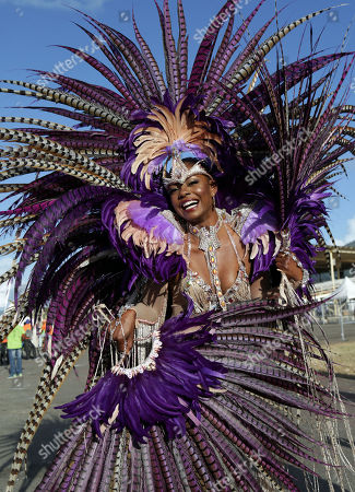 Stock Photo of Trinidadian Wendy Fitzwilliam, Miss Universe 1998, wears a suit designed by Harts Carnival during her participation in the parade of bands of the Carnival of Trinidad and Tobago at the Queen's Park Savannah in the city of Puerto de Spain, Trinidad and Tobago, 13 February 2018.