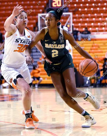 Didi Richards, Maria Castro. Baylor guard Didi Richards (2) drives past Oklahoma State forward Maria Castro (30) during the second half of a NCAA college basketball game in Stillwater, Okla., . Richards scored 4 points in the 87-45 win over Oklahoma State