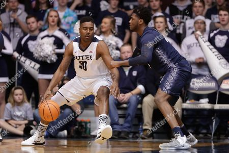 Marcus Derrickson, Kelan Martin. Butler forward Kelan Martin (30) drives on Georgetown forward Marcus Derrickson (24) in the second half of an NCAA college basketball game in Indianapolis, . Georgetown defeated Butler 87-83