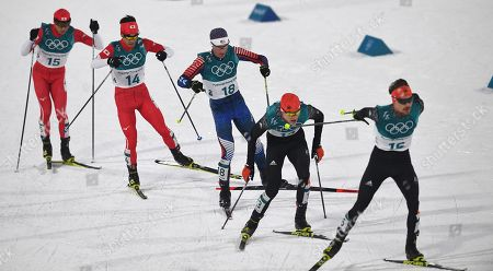 Stock Picture of (L-R) Go Yamamoto of Japan, Hideaki Nagai of Japan, Bryan Fletcher of the USA, Vinzenz Geiger of Germany and Fabian Riessle of Germany in action during the Cross Country portion of the Nordic Combined Individual Normal Hill / 10 km competition at the Alpensia Ski Jumping Centre during the PyeongChang 2018 Olympic Games, South Korea, 14 February 2018.