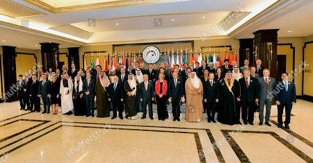 Foreign minsters and heads of delegations including Kuwait Prime Minister Jaber Al-Mubarak Al-Hamad Al-Sabah (C), UN Secretary-General Antonio Guterres  (C-R), Iraqi Prime Minster Haider al-Abadi (C-R) pose for group photo ahead of Ministerial Level Conference at Kuwait International Conference for the Reconstruction of Iraq, in Kuwait City, Kuwait, 14 February 2018.