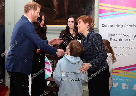 Prince Harry and Meghan Markle meet First Minister Nicola Sturgeon during a reception for young people at the Palace of Holyroodhouse, in Edinburgh, during their visit to Scotland.