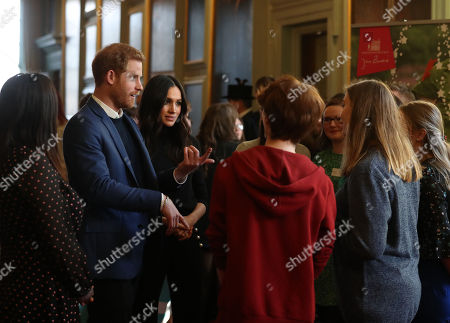 Prince Harry and Meghan Markle during a reception for young people at the Palace of Holyroodhouse, in Edinburgh, during their visit to Scotland.