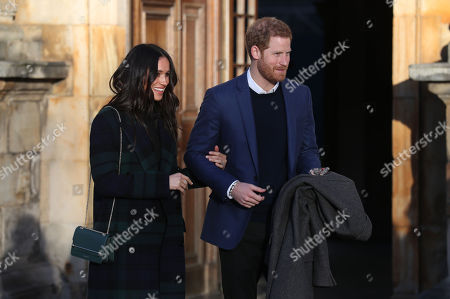 Prince Harry and Meghan Markle leave a reception for young people at the Palace of Holyroodhouse, in Edinburgh, during their visit to Scotland.
