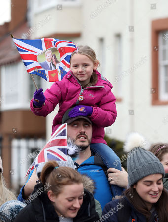 Hannah Davey, 6, joins crowds ahead of a visit by Prince Harry and Meghan Markle to Edinburgh Castle.