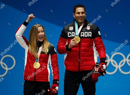 Curling mixed doubles gold medalists Kaitlyn Lawes, left, and John Morris, of Canada, celebrate during the medals ceremony at the 2018 Winter Olympics in Pyeongchang, South Korea