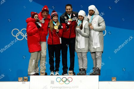 Curling mixed doubles medalists from left, Switzerland's Jenny Perret and Martin Rios, silver, Canada's Kaitlyn Lawes and John Morris, gold, and Russian athletes Anastasia Bryzgalova and Aleksandr Krushelnitckii, bronze, pose during their medals ceremony at the 2018 Winter Olympics in Pyeongchang, South Korea