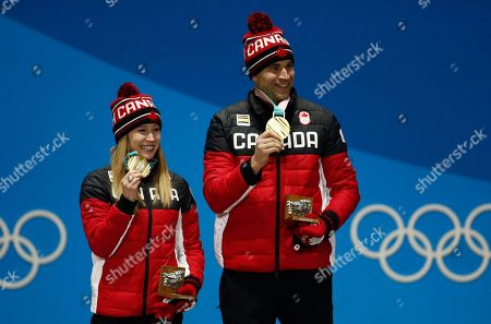 Curling mixed doubles gold medalists Kaitlyn Lawes, left, and John Morris, of Canada, smile during their medals ceremony at the 2018 Winter Olympics in Pyeongchang, South Korea