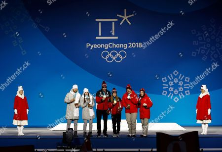 Curling mixed doubles medalists from right, Switzerland's Jenny Perret and Martin Rios, silver, Canada's Kaitlyn Lawes and John Morris, gold, and Russian athletes Anastasia Bryzgalova and Aleksandr Krushelnitckii, bronze pose during their medals ceremony at the 2018 Winter Olympics in Pyeongchang, South Korea
