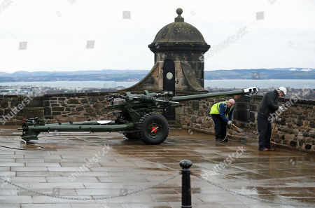 The one o'clock gun being cleaned ahead of a visit by Prince Harry and Meghan Markle to Edinburgh Castle.