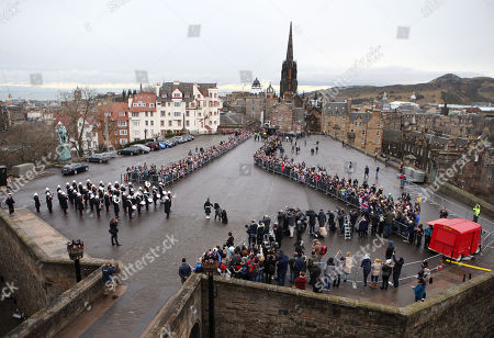 Crowds gather ahead of a visit by Prince Harry and Meghan Markle to Edinburgh Castle.
