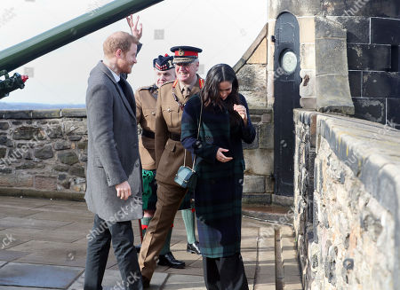 Prince Harry and Meghan Markle by the One o'clock gun at Edinburgh Castle, during their visit to Scotland.