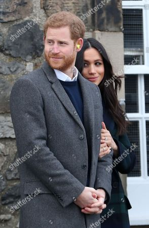 Prince Harry and Meghan Markle after watching the firing of the One o'clock gun at Edinburgh Castle, during their visit to Scotland.