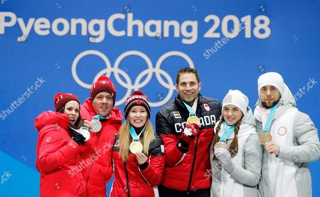 Gold medal winners John Morris (center R) and Kaitlyn Lawes of Canada, silver medalists Roman Rios (2L) and Jenny Perret (L) of Switzerland and bronze medalists, Olympic Athletes from Russia Aleksandr Krushelnitckii (R) and Anastasia Bryzgalova during the medal ceremony for the Curling Mixed Doubles event at the PyeongChang 2018 Olympic Games, South Korea, 14 February 2018.
