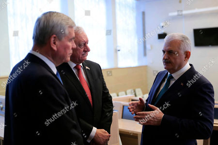 Turkey's Prime Minister Binali Yildirim, right, speaks with Chairman of the Council of the Republic of the National Assembly of Belarus Mikhail Myasnikovich, center, and Vladimir Andreychenko, Chairman of the House of Representatives of the National Assembly of Belarus, before a meeting in Minsk, Belarus, . Yildirim is in Belarus for a two-day visit