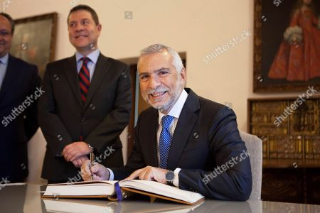 Italian Ambassador in Spain, Stefano Sannino (C), signs the guest book after a meeting with Castilla-La Mancha regional President, Emiliano Garcia Page (2-R), in Toledo, central Spain, 14 February 2018. The meeting was focused in different issues of interest for the Spanish region and Italy.