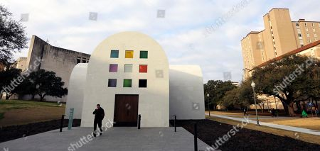 """A man passes Ellsworth Kelly's """"Austin"""" at the Blanton Museum of Art, in Austin, Texas. The exhibit, a 2,715-square-foot stone building with luminous colored glass windows is set to open to the public Sunday"""