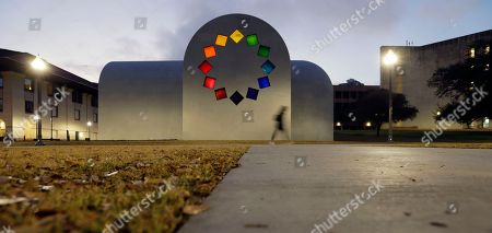 """Stock Photo of A woman passes Ellsworth Kelly's """"Austin"""" at the Blanton Museum of Art, in Austin, Texas. The exhibit, a 2,715-square-foot stone building with luminous colored glass windows is set to open to the public Sunday"""