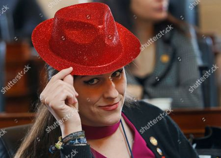 Del. Danica Roem, D-Prince William, dons a traditional red hat worn by female legislators prior to the start of the House session at the Capitol in Richmond, Va., . The apparel is a Valentine Day tradition