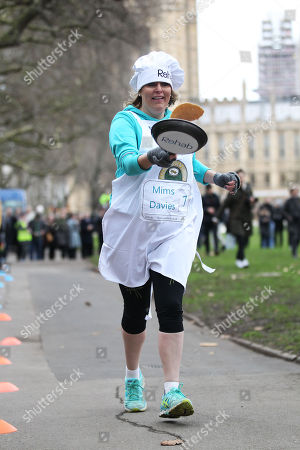 Parliamentarians flip their pancakes at the start of the annual shrove Tuesday Pancake Race at Victoria Tower Gardens against the Parliament Media Team Pictured-Conservative Government Assistant Whip Mims Davies
